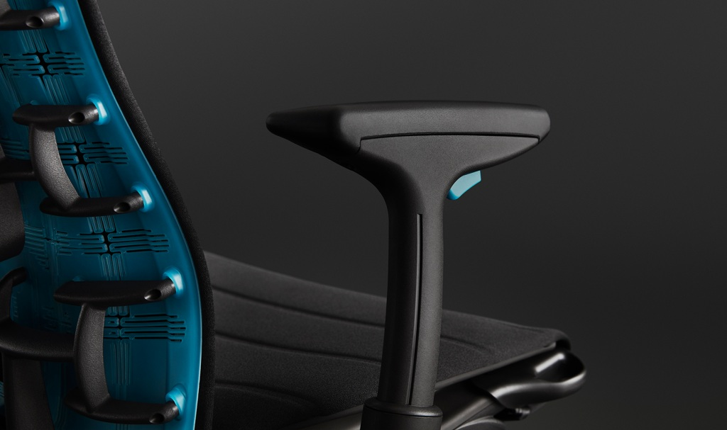 Gaming chair armrest button