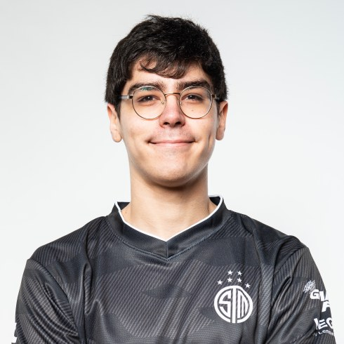 a portrait of dardoch, he has glasses and has a small smile